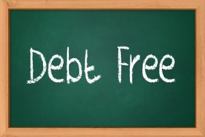 debt free spelled out with white chalk on a dark green blackboard
