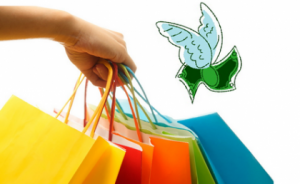 Lady's hand holding multiple shopping bags while a pair of wings fly away with her dollars