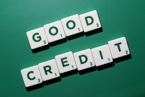 good credit spelled out with green letters on white scrabble tokens sitting on a green background